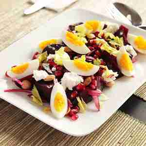 Roasted Beet Salad With Goat Cheese, Eggs, Pomegranate, and Marcona Almond Vinaigrette Recipe