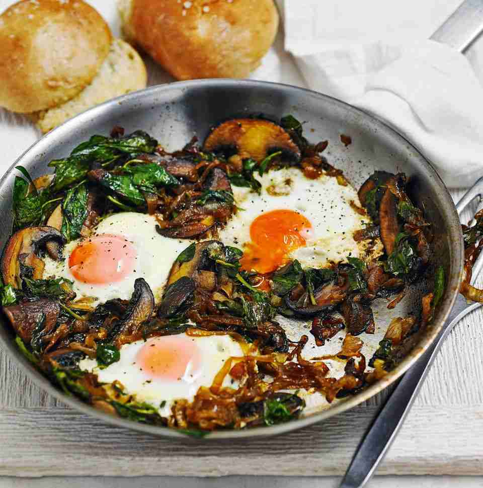Fried eggs with spicy onions and spinach recipe | delicious. magazine